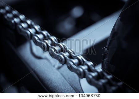 Close up image of a used motorcycle chain.