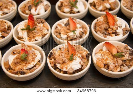 A Yummy banoffee dessert served with bananas.
