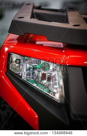 Detail on one of the LED headlights of an ATV.