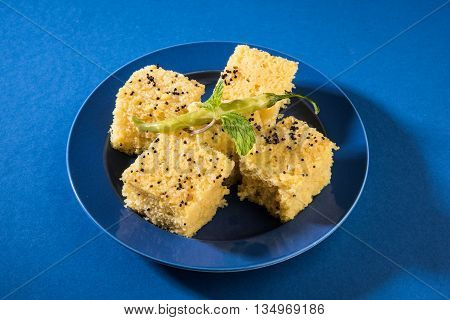 Gujrati famous snack made up of gram flour, semolina called khaman Dhokla