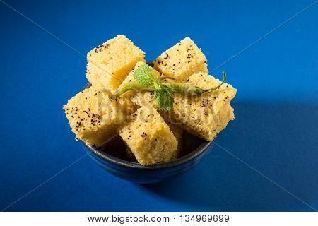 Gujrati famous snack made up of gram flour, semolina called khaman Dhokla