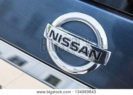 Nissan Car Logo Mounted On Rear Door