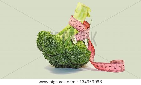 Isolated green broccoli with red centimeter on it.