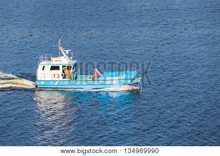 Small Blue Cargo Boat Goes On Baltic Sea