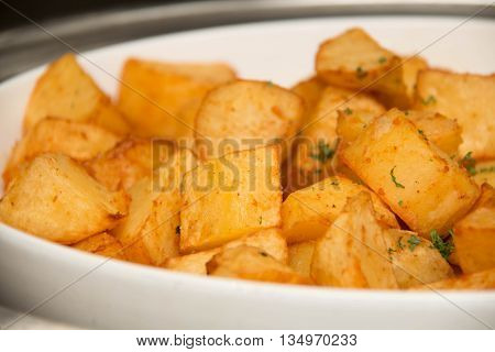 bowl container full of fried potato wedges