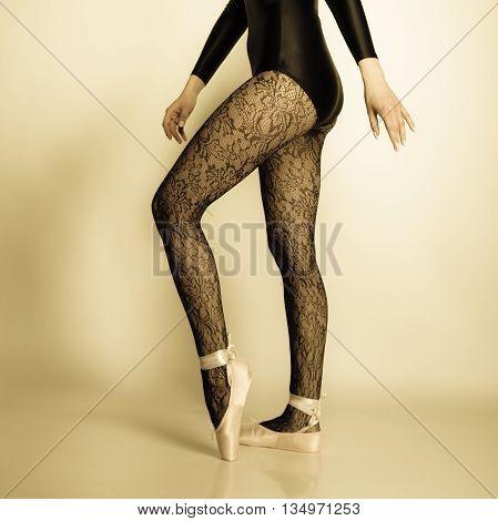 Female Legs Dancer In Ballet Shoes