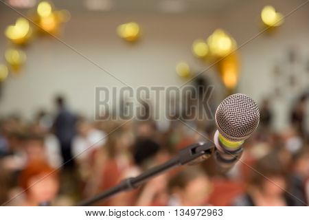 The first performance on stage with a microphone.