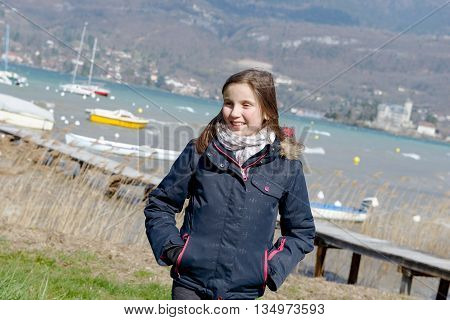a preteen girl with hair in the wind