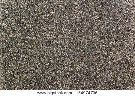 The texture of small gravel on the road