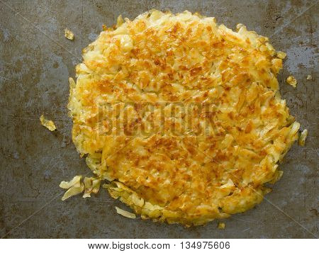 close up of rustic golden crispy swiss rosti