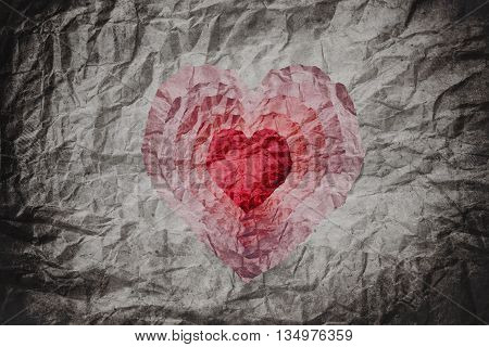 Crumpled paper texture with cut as heart shape in many layers, abstract heart background, collage style