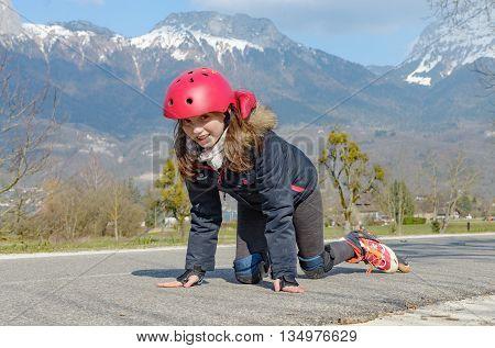 a pretty preteen girl on roller skates in helmet