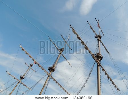 mast of the ship on blue sky background