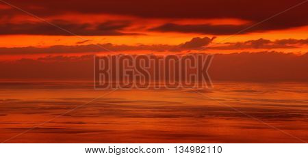 Beautiful sunset over sea, red dramatic skyscape, amazing evening panoramic scene, wonderful nature background