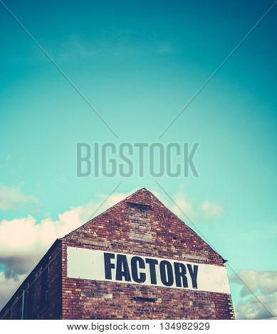 Urban Industrial Red Brick Factory Building With Blue Sky And Copy Space