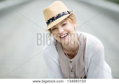 Headshot Portrait Of Young Happy Woman Laughing Outdoors