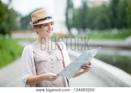 Young Traveler Woman Checking Out Sights On Map