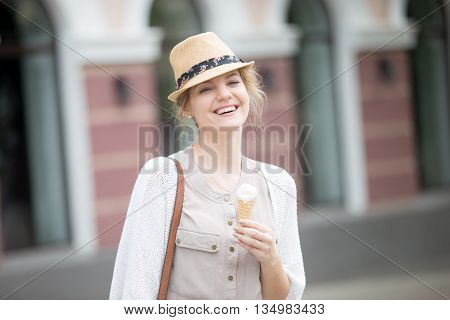 Headshot Portrait Of Young Happy Woman Eating Ice-cream Cone In Summer