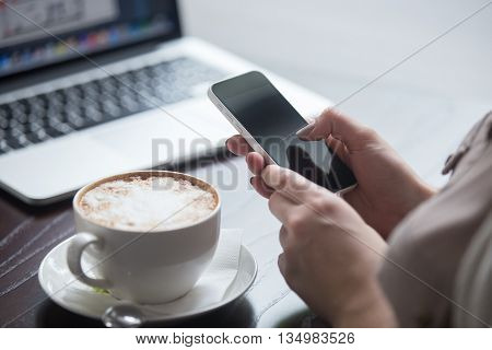 Woman Using Electronic Devices In Cafe. Close-up