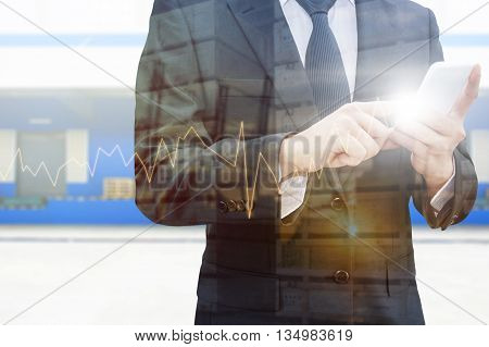 Double exposure of professional businessman using smart phone city centre of business with blurred transportation port and distribution cargo warehouse background Technology Transportation & Business trading concept
