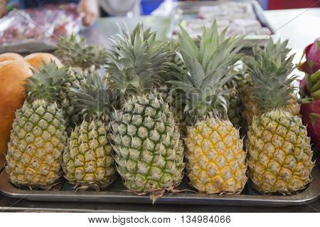 pine apples on the Tray in Thailand market