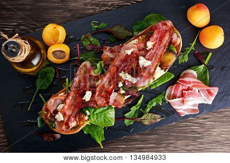 Grilled summer ciabatta with caramelized apricots, bacon, mozzarella, green salad