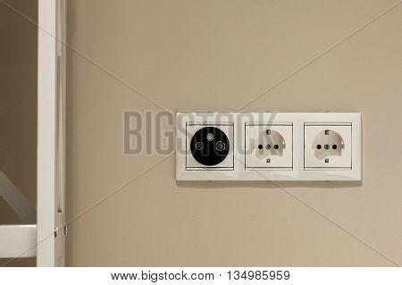 two electrical outlet on the wall in the room