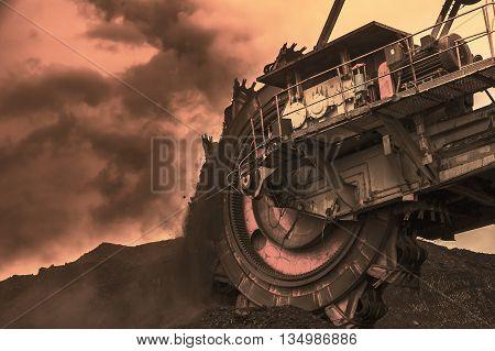 Giant bucket wheel excavator, dramatic cloudy sky
