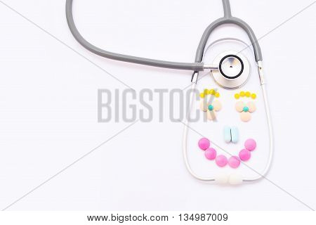 Stethoscope with drugs on white background, good healthy concept