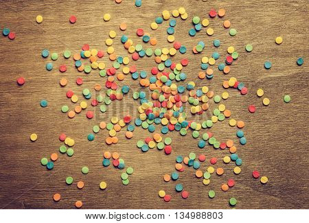 Sugar pearls for food decoration on wooden backgrond