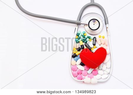 Heart, stethoscope and drugs, heart healthy concept