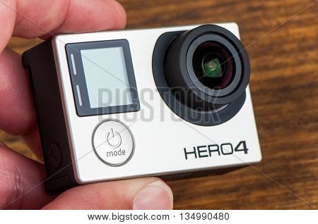 NOVI SAD SERBIA - JUNE 19 2016: GoPro Hero 4 Black waterproof action camera announced in september 2014 captures slow motion at up to 240 frames per second illustrative editorial