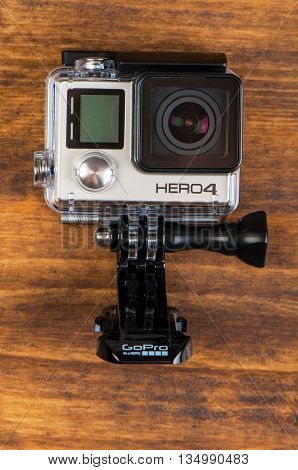 NOVI SAD SERBIA - JUNE 19 2016: GoPro Hero 4 Black waterproof action camera announced in september 2014 weights only 152g with waterproof housing illustrative editorial