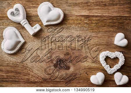 chalk heart and key on wood and happy valentines day written