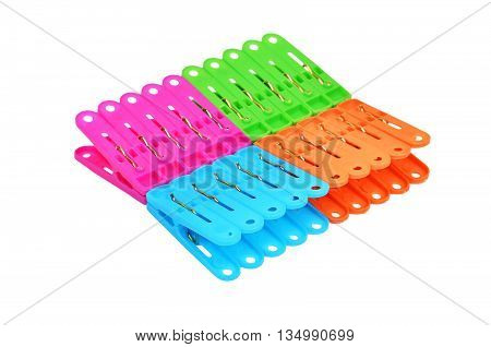 Color clothes pegs isolated on white background