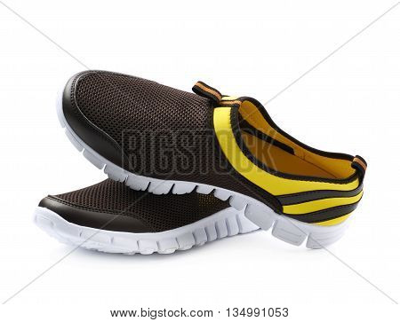 Pair of two light running sport shoes, colored yellow and black, composition isolated over the white background