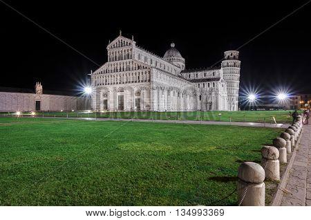 Italy, Pisa, Piazza del Duomo - Cattedrale di Pisa and Torre di Pisa on background.