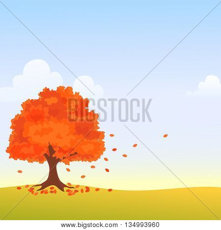 Autumn tree in field with falling leaves