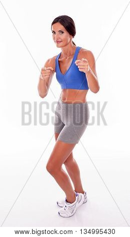 Smiling Brunette Woman Pointing On White