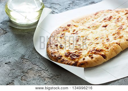 Georgian bread with cheese on a concrete background