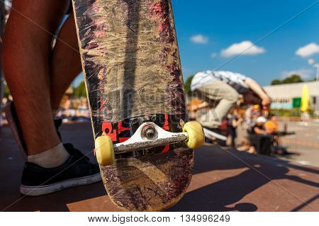 Competitions for skateboarding and scratched skateboard. Conceptual image.