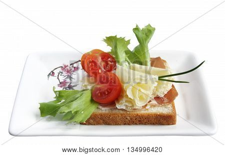 Swiss Cheese Speciality - Tete de Moine Rosettes with tomato on a wholewheat toast