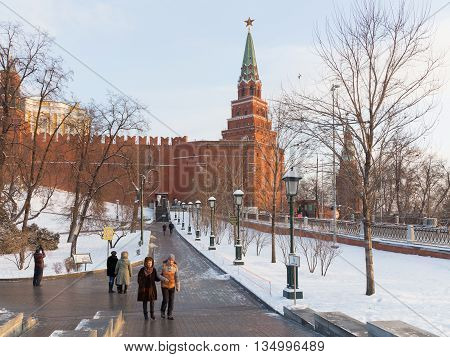 Moscow - January 7 2016: A lot of people walk around the Kremlin walls in the Alexander Garden winter and white snow in the Park January 7 2016 Moscow Russia