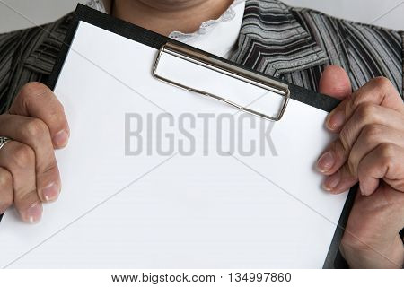 leader holding a document business plan close up