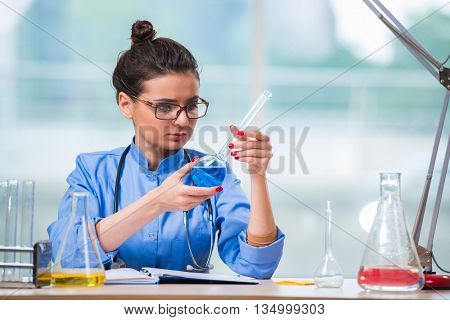 Woman doctor doing chemical tests in laboratory