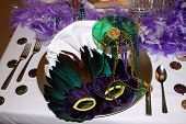 stock photo of mardi-gras  - a mask gold beads green glass with coins - JPG