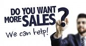 Business Man Pointing the Text: Do You Want More Sales? We Can Help! poster