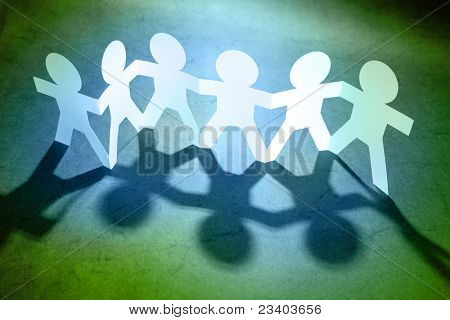 Group of paper doll people holding hands