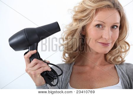 Woman with a hairdryer