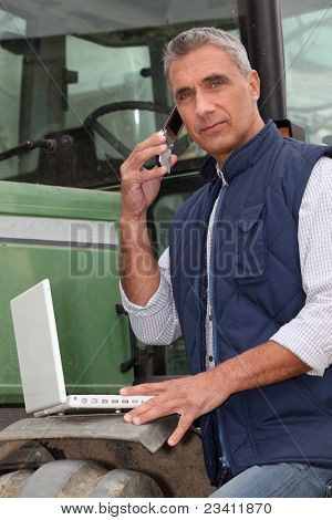 Farmer with a laptop and cellphone